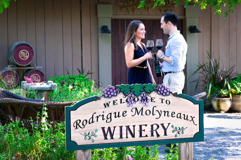 Couple Sharing Bottle Of Wine, Rodrigue Molineaux Winery, Livermore, CA
