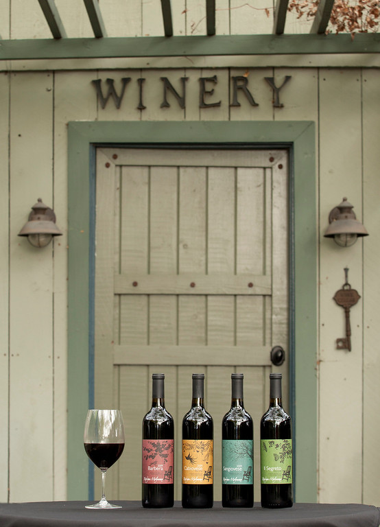 Collection of Rodrigue Molineaux Wines In Front Of Winery Production Door