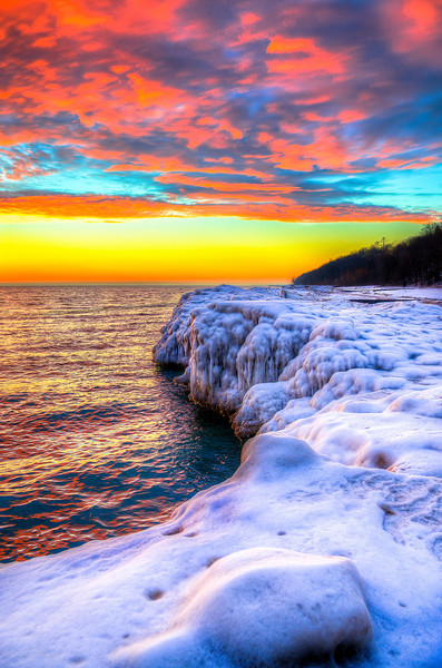 Sunrise via HDR on Lake Michigan North of Chicago 1-14-14. This was after a brief rain the night before which certainly reshaped the ice formations. It was 35°F on the 12th of January which made shooting a little easier based on it not actually being freezing. Lake Michigan is a great place and from north of Chicago you can always catch a great sunrise.