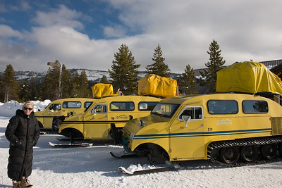Snow coaches to Old Faithful Lodge.