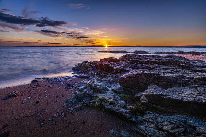 A beautiful sunset at Lighthouse Point Park in New Haven, Connecticut, USA.