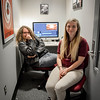 From left, Lowell High students Alec Harmon and Felicia Whiting hang out in the Edit Room and show guests some projects they've been working on. SUN/Caley McGuane