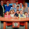 The Creegan Family takes a group photo in the Creegan Media Studio at Lowell High. SUN/Caley McGuane