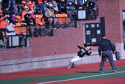 Third baseman Andy Armstrong attempts to catch a foul ball. Oregon State won 4 to 2 vs. West Virginia.  Photo for the Corvallis Gazette Times by Leon Neuschwander