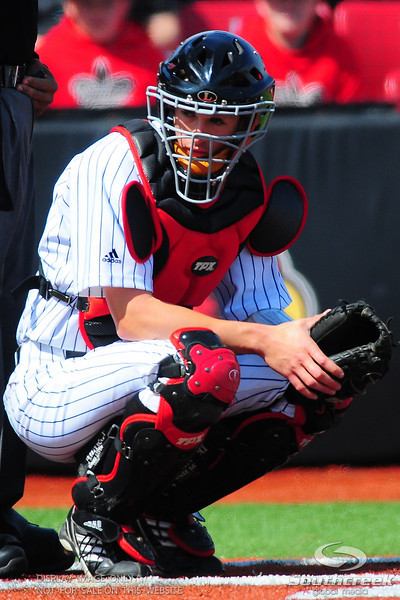 Louisville Cardinals catcher (35) J.J. Ethel looks for the sign from the dugout.  Div. 1 NCAA baseball game between the Louisville Cardinals and the Xavier Musketeers at the Jim Patterson Stadium in Louisville, KY.  (19) Louisville Cardinals defeated the Xavier Musketeers 3-0.