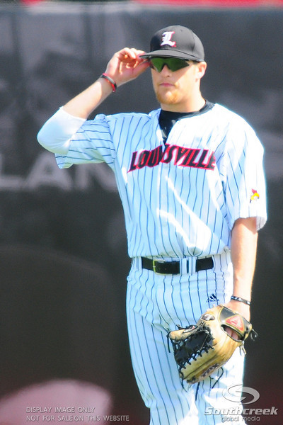 Louisville Cardinals third baseman (25) Cade Stallings.  Div. 1 NCAA baseball game between the Louisville Cardinals and the Xavier Musketeers at the Jim Patterson Stadium in Louisville, KY.  (19) Louisville Cardinals defeated the Xavier Musketeers 3-0.