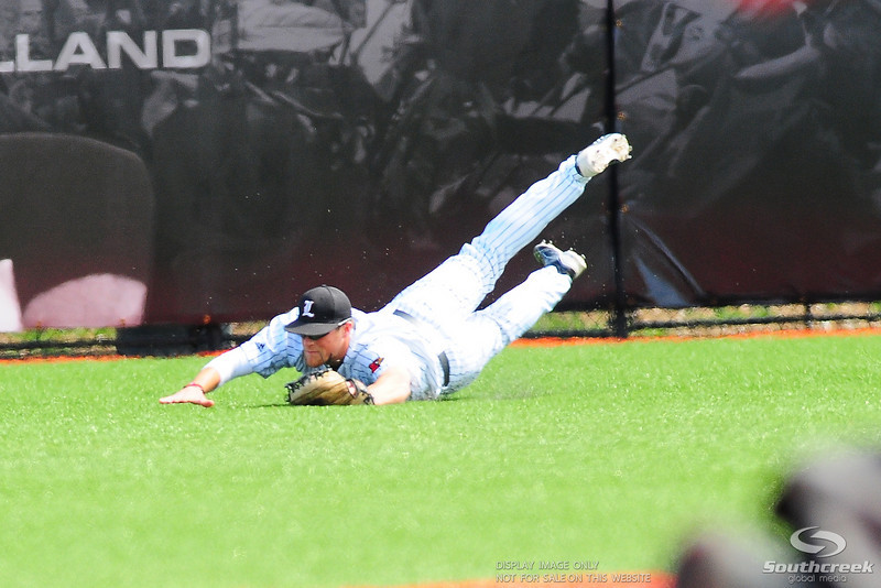 Louisville Cardinals right fielder (5) Stewart Ijames makes a diving catch.  Div. 1 NCAA baseball game between the Louisville Cardinals and the Xavier Musketeers at the Jim Patterson Stadium in Louisville, KY.  (19) Louisville Cardinals defeated the Xavier Musketeers 3-0.