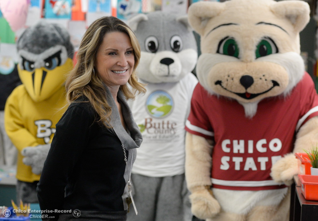 . Kristin Schrock, Principal at Little Chico Creek Elementary School smiles in front of mascots from Chico State, Butte College and BCOE as Butte County Educational leaders gather at Little Chico Creek Elementary School in Chico, Calif. to sign the Butte County Promise Thursday Feb. 1, 2018. The Promise is to all students in Butte County for an opportunity at a college education. (Bill Husa -- Enterprise-Record)