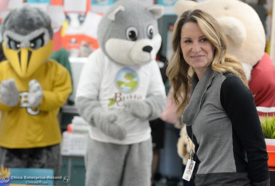 Kristin Schrock, Principal at Little Chico Creek Elementary School smiles in front of mascots from Chico State, Butte College and BCOE as Butte County Educational leaders gather at Little Chico Creek Elementary School in Chico, Calif. to sign the Butte County Promise Thursday Feb. 1, 2018. The Promise is to all students in Butte County for an opportunity at a college education. (Bill Husa -- Enterprise-Record)