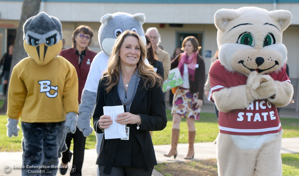 . Kristin Schrock, Principal at Little Chico Creek Elementary School leads mascots and Butte County Educational representatives to a classroom as Butte County Educational leaders gather at Little Chico Creek Elementary School in Chico, Calif. to sign the Butte County Promise Thursday Feb. 1, 2018. The Promise is to all students in Butte County for an opportunity at a college education. (Bill Husa -- Enterprise-Record)