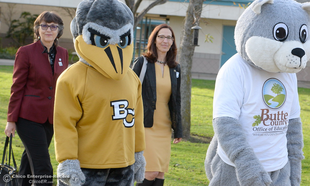 . CSUC President Gayle Hutchinson, left and Butte College President Samia Yaqub walk behind mascots as Butte County Educational leaders gather at Little Chico Creek Elementary School in Chico, Calif. to sign the Butte County Promise Thursday Feb. 1, 2018. The Promise is to all students in Butte County for an opportunity at a college education. (Bill Husa -- Enterprise-Record)