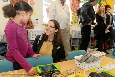 Butte College President Samia Yaqub smiles as she meets with a student while Butte County Educational leaders gather at Little Chico Creek Elementary School in Chico, Calif. to sign the Butte County Promise Thursday Feb. 1, 2018. The Promise is to all students in Butte County for an opportunity at a college education. (Bill Husa -- Enterprise-Record)