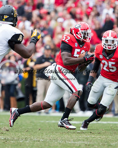 Georgia Bulldogs linebacker Amarlo Herrera (52) runs with an interception
