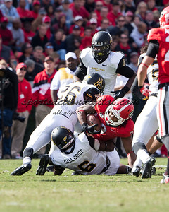 Appalachian State Mountaineers defensive back Joel Ross (26) and Appalachian State Mountaineers linebacker Kennan Gilchrist (6) tackle Georgia Bulldogs running back Todd Gurley (3)