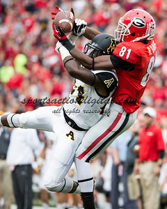 Georgia Bulldogs wide receiver Reggie Davis (81) catches a pass over Appalachian State Mountaineers defensive back Dante Blackmon (24)