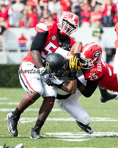 Appalachian State Mountaineers running back Marcus Cox (14), Georgia Bulldogs safety Josh Harvey-Clemons (25), Georgia Bulldogs defensive end Sterling Bailey (58)