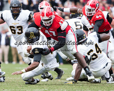 Georgia Bulldogs defensive end Ray Drew (47) sacks Appalachian State Mountaineers quarterback Kameron Bryant (5)