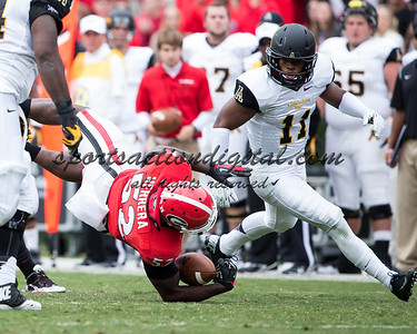 Georgia Bulldogs linebacker Amarlo Herrera (52) is tackled after his interception resulting in a fumble recovered by Appalachian State