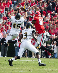 Appalachian State Mountaineers linebacker Karl Anderson (45), Appalachian State Mountaineers defensive back Alex Gray (3), Georgia Bulldogs tight end Jay Rome (87)
