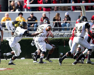 Appalachian State Mountaineers quarterback Kameron Bryant (5) pitches the ball to Appalachian State Mountaineers running back Marcus Cox (14)