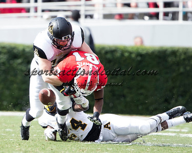 Georgia Bulldogs wide receiver Reggie Davis (81) has the pass knocked away by Appalachian State Mountaineers linebacker Patrick Blalock (34) and Appalachian State Mountaineers defensive back Dante Blackmon (24)