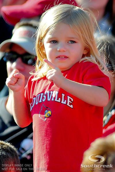 Little Louisville Cardinals fan during the game .  West Virginia Mountaineers leads Louisville Cardinals 14 -10 at the half PaPa Johns Cardinal Stadium Louisville, Kentucky.