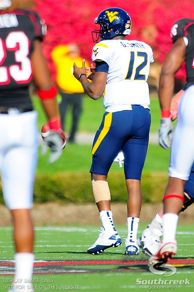 As the ball is snapped West Virginia Mountaineers quarterback Geno Smith (12) calls a time out.  West Virginia Mountaineers leads Louisville Cardinals 14 -10 at the half PaPa Johns Cardinal Stadium Louisville, Kentucky.