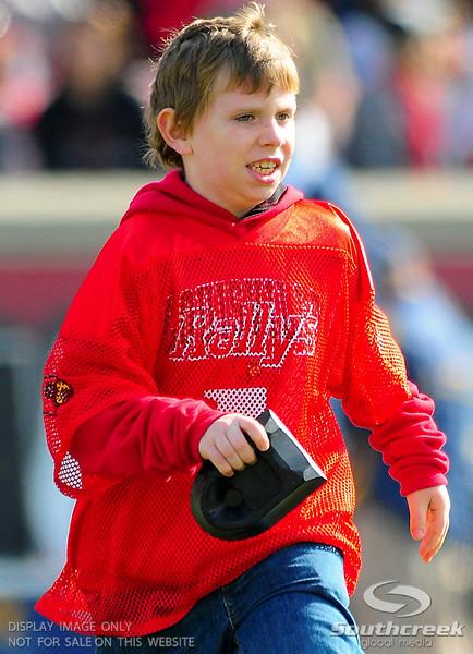 Louisville Cardinals ornery ball boy.  West Virginia Mountaineers leads Louisville Cardinals 14 -10 at the half PaPa Johns Cardinal Stadium Louisville, Kentucky.