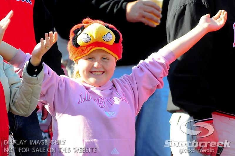 .  West Virginia Mountaineers leads Louisville Cardinals 14 -10 at the half PaPa Johns Cardinal Stadium Louisville, Kentucky.