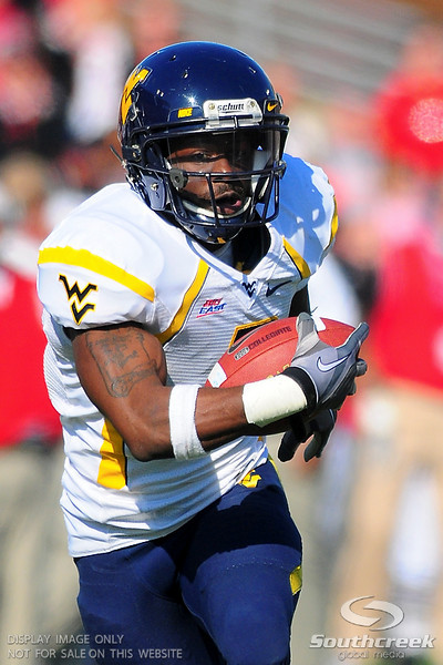 West Virginia Mountaineers running back Noel Devine (7) gets to the goal line after a 48 yard reception during the game.  West Virginia Mountaineers leads Louisville Cardinals 14 -10 at the half PaPa Johns Cardinal Stadium Louisville, Kentucky.