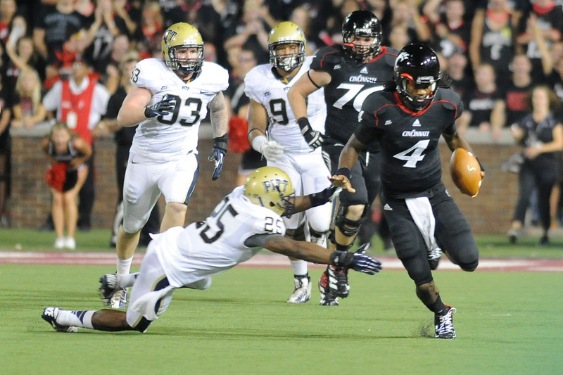 Cincinnati Bearcats quarterback Munchie Legaux (4) breaks away for seventy seven yards in the second quarter.  Cincinnati Bearcats defeated Pittsburgh Panthers 34-10 at Nippert Stadium in Cincinnati, Ohio.