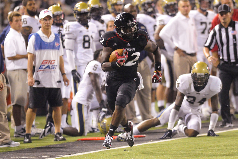 Cincinnati Bearcats running back Jameel Poteat (22) for positive yards in the second half.  Cincinnati Bearcats defeated Pittsburgh Panthers 34-10 at Nippert Stadium in Cincinnati, Ohio.