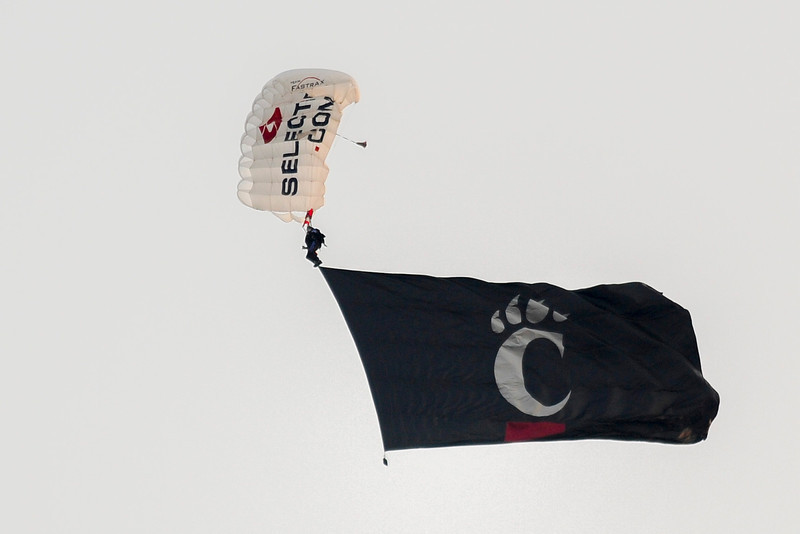 Parachutes drop out of the sky before the game.  Cincinnati Bearcats defeated Pittsburgh Panthers 34-10 at Nippert Stadium in Cincinnati, Ohio.