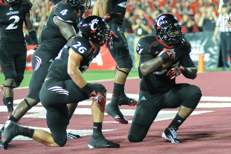 Cincinnati Bearcats linebacker Greg Blair (51) celebrates with Cincinnati Bearcats defensive back Drew Frey (26) after making interception in the end zone.  Cincinnati Bearcats lead Pittsburgh Panthers 17-0 at halftime at Nippert Stadium in Cincinnati, Ohio.