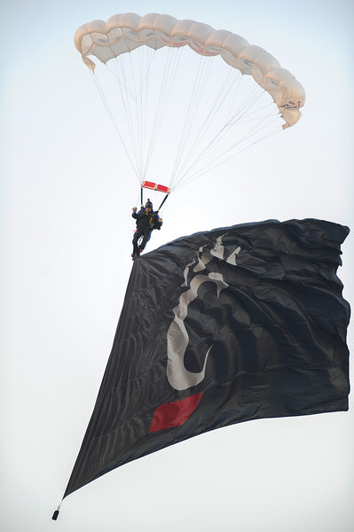 Parachutes drop in before the game.  Cincinnati Bearcats defeated Pittsburgh Panthers 34-10 at Nippert Stadium in Cincinnati, Ohio.