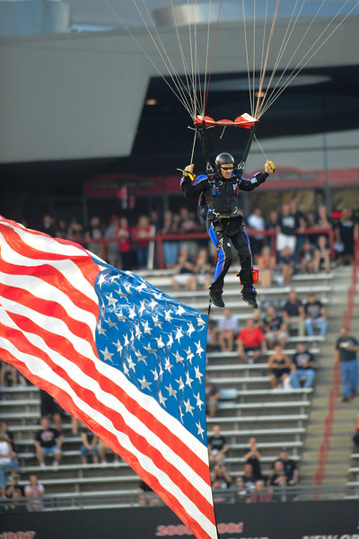 Parachute drops in before the game with the American flag.   Cincinnati Bearcats defeated Pittsburgh Panthers 34-10 at Nippert Stadium in Cincinnati, Ohio.