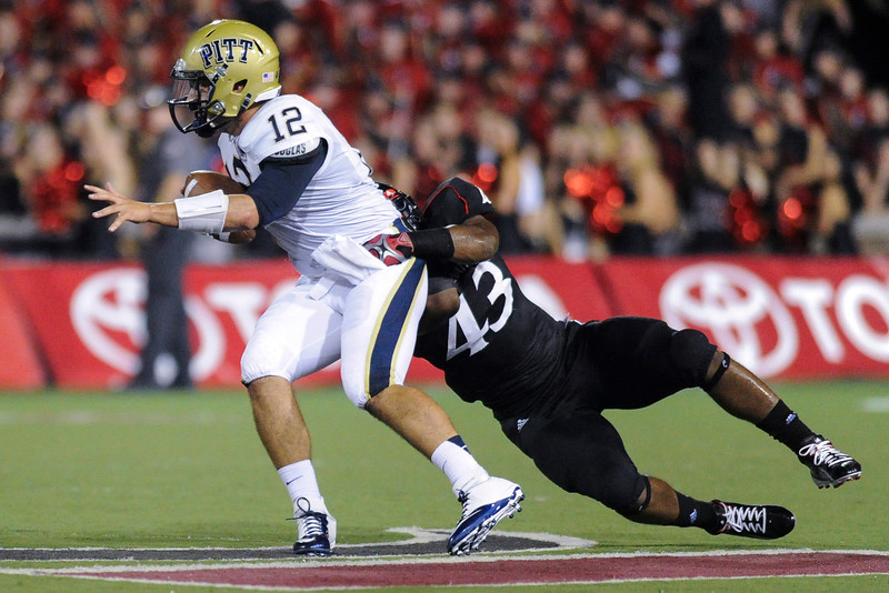 Cincinnati Bearcats linebacker Nick Temple (43) sacks Pittsburgh Panthers quarterback Tino Sunseri (12).  Cincinnati Bearcats lead Pittsburgh Panthers 17-0 at halftime at Nippert Stadium in Cincinnati, Ohio.