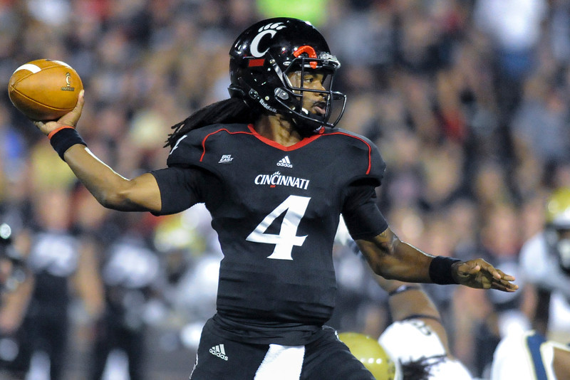 Cincinnati Bearcats quarterback Munchie Legaux (4) during the game.  Cincinnati Bearcats lead Pittsburgh Panthers at halftime 17-0 at Nippert Stadium in Cincinnati, Ohio.