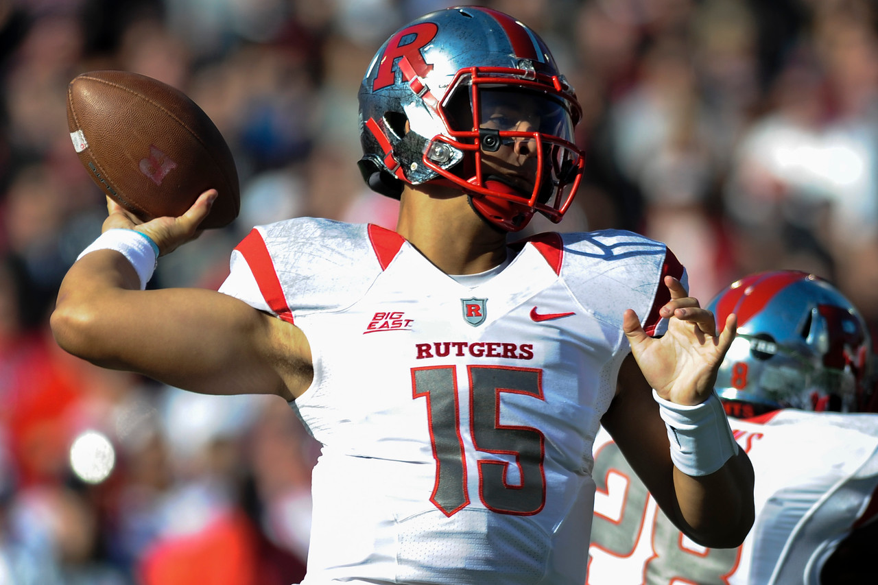 Rutgers Scarlet Knights quarterback Gary Nova (15) passes for the only score in the first half.  Rutgers Scarlet Knights lead Cincinnati Bearcats (7-0) at the half at Nippert Stadium in Cincinnati, Ohio.