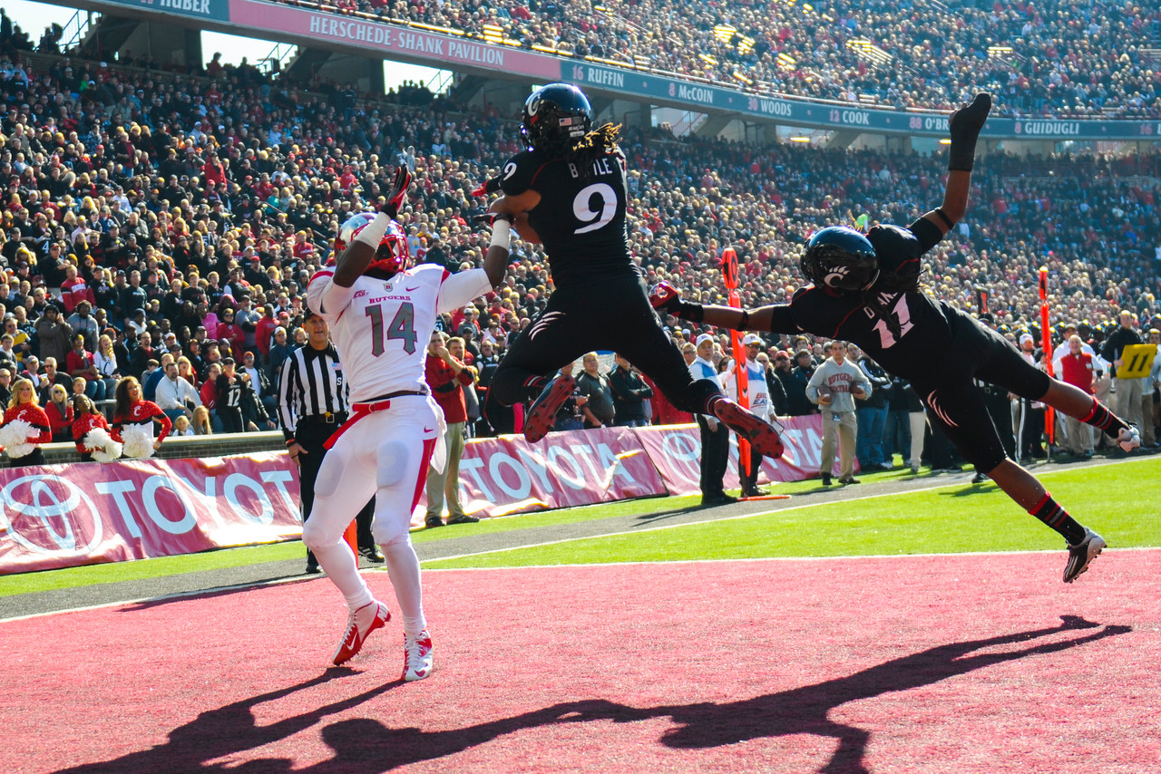 Cincinnati Bearcats defensive back Dominique Battle (9) comes up with the interception in the end zone over Rutgers Scarlet Knights wide receiver Miles Shuler (14).   Rutgers Scarlet Knights lead Cincinnati Bearcats (7-0) at the half at Nippert Stadium in Cincinnati, Ohio.