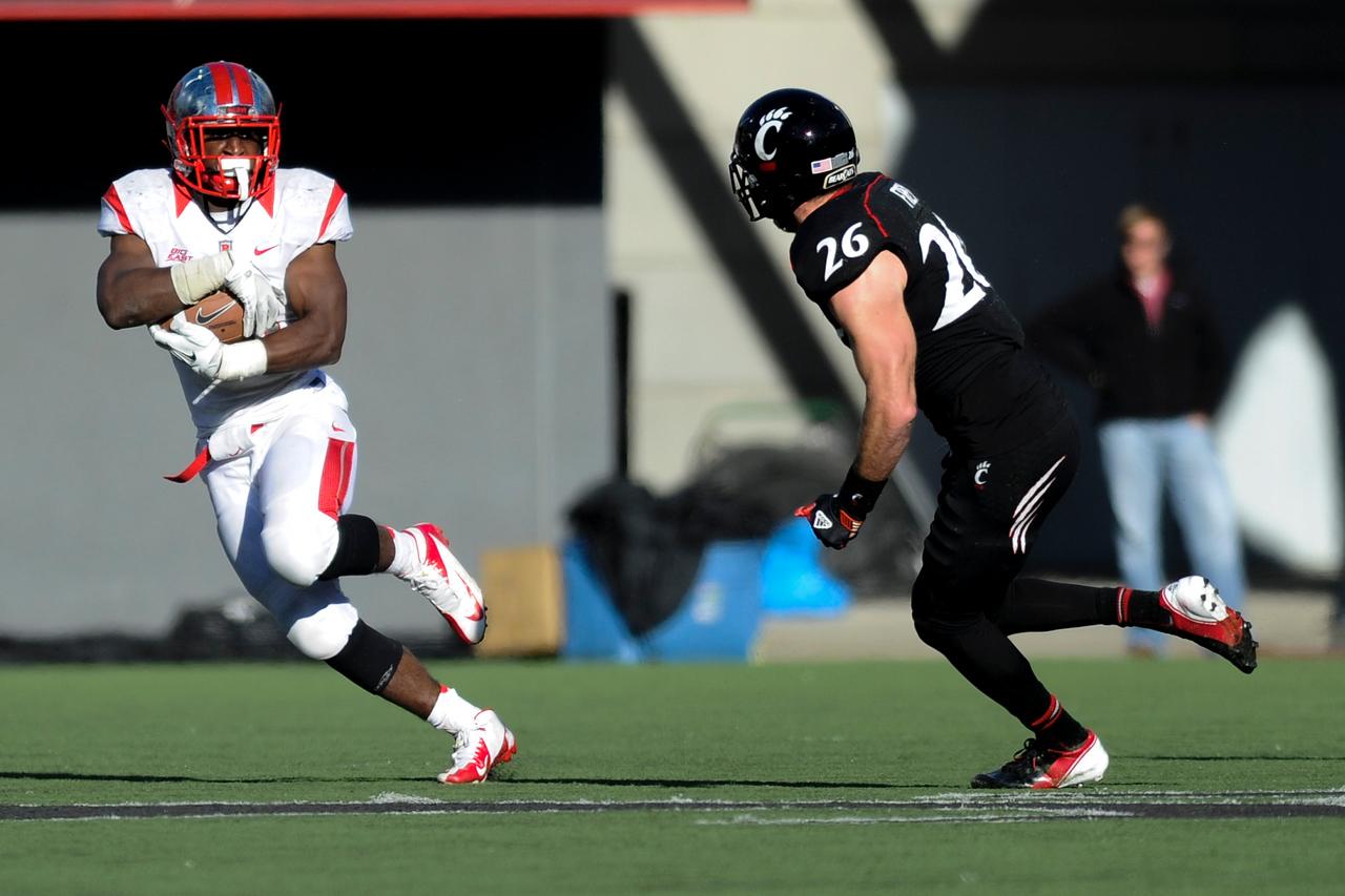 Rutgers Scarlet Knights wide receiver Tim Wright (5) try's to get past Cincinnati Bearcats defensive back Drew Frey (26).  Rutgers Scarlet Knights defeated Cincinnati Bearcats (10-3) at the half at Nippert Stadium in Cincinnati, Ohio.