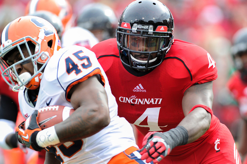 Syracuse Orange running back Jerome Smith (45) is being chased by Cincinnati Bearcats linebacker Maalik Bomar (4) during the game.  Cincinnati Bearcats defeated Syracuse Orange (35-24) at Nippert Stadium in Cincinnati, Ohio.