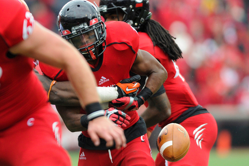 Cincinnati Bearcats running back Ralph Abernathy (1) fumbles the ball during the game.  Syracuse Orange lead Cincinnati Bearcats (17-14) at the half at Nippert Stadium in Cincinnati, Ohio.