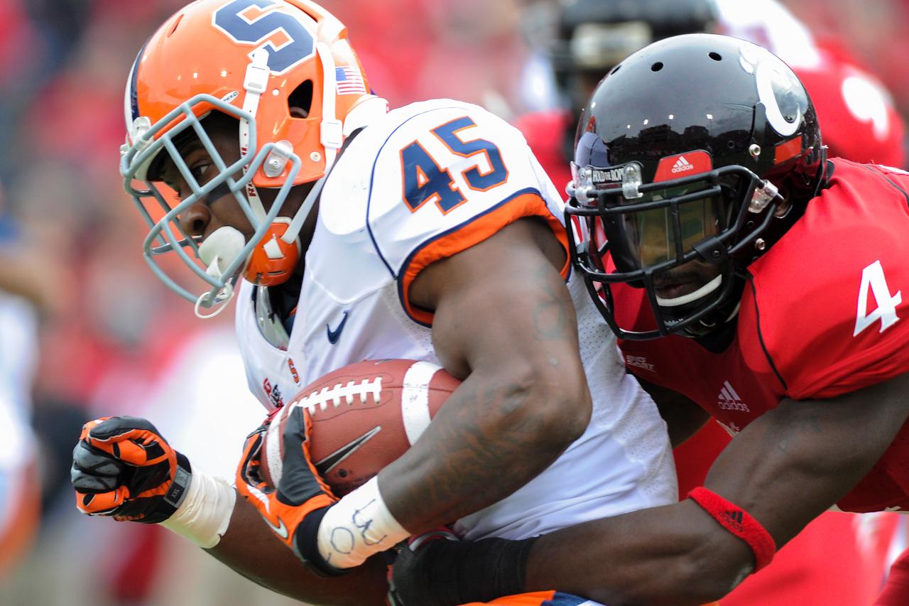 Cincinnati Bearcats linebacker Maalik Bomar (4) tacklesSyracuse Orange running back Jerome Smith (45) during the game.  Syracuse Orange lead Cincinnati Bearcats (17-14) at the half at Nippert Stadium in Cincinnati, Ohio.
