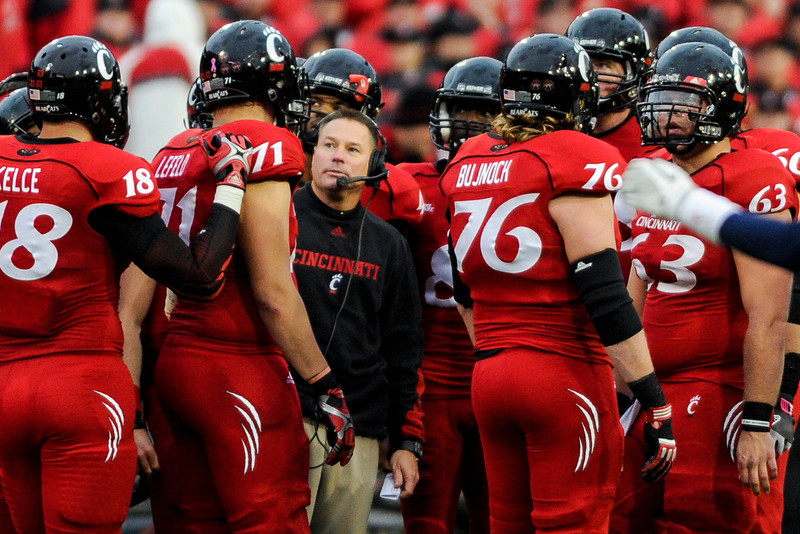 Cincinnati Bearcats head coach Butch Jones talks during a timeout.  Cincinnati Bearcats defeated Syracuse Orange (35-24) at Nippert Stadium in Cincinnati, Ohio.