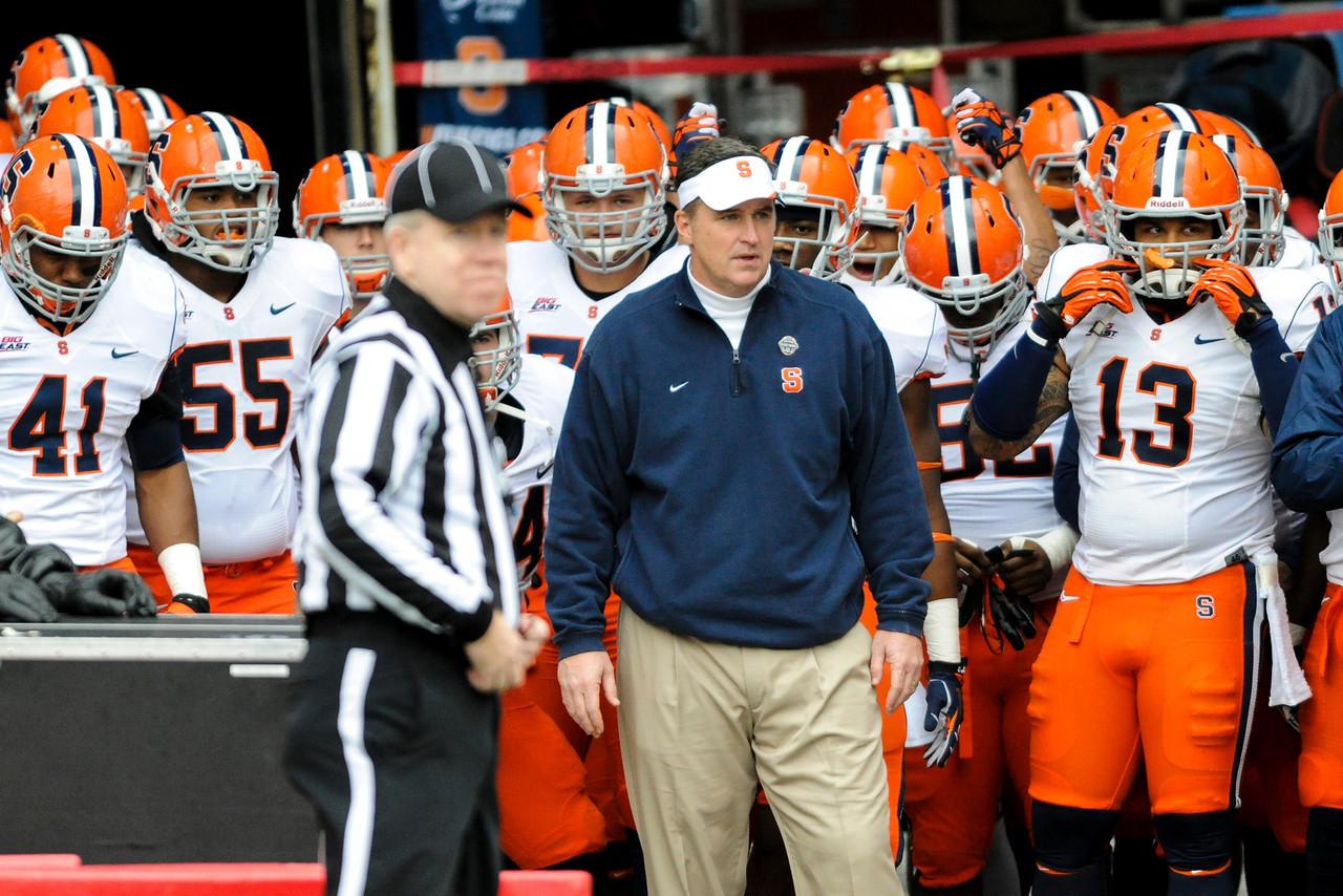 Syracuse Orange head coach Doug Marrone waits to bring Syracuse Orange on the field before the game.  Cincinnati Bearcats defeated Syracuse Orange (35-24) at Nippert Stadium in Cincinnati, Ohio.
