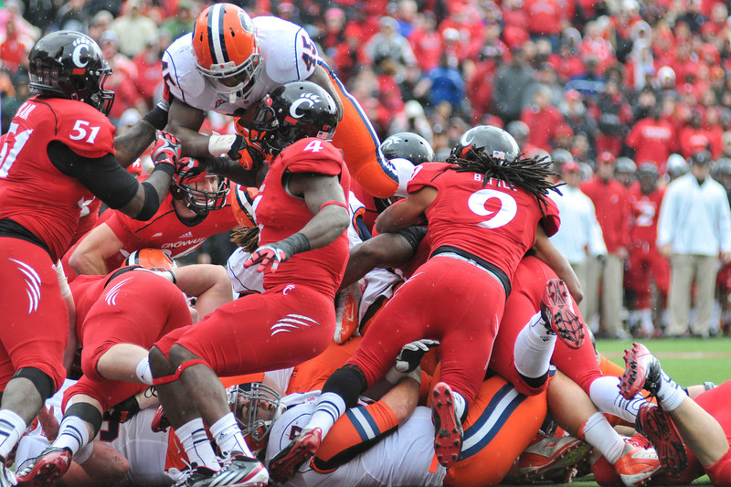 Syracuse Orange running back Jerome Smith (45) dives over the pile for a touchdown.  Cincinnati Bearcats defeated Syracuse Orange (35-24) at Nippert Stadium in Cincinnati, Ohio.
