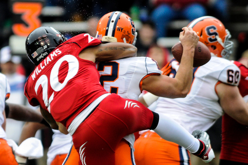 Syracuse Orange quarterback Ryan Nassib (12) looses the ball as Cincinnati Bearcats defensive back Chris Williams (20) sacks him from behind.  Cincinnati Bearcats defeated Syracuse Orange (35-24) at Nippert Stadium in Cincinnati, Ohio.