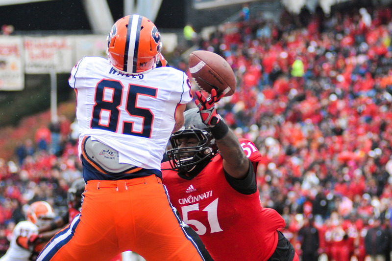 Cincinnati Bearcats linebacker Greg Blair (51) breaks up a pass on Syracuse Orange tight end Beckett Wales (85) in the endzone.  Syracuse Orange lead Cincinnati Bearcats (17-14) at the half at Nippert Stadium in Cincinnati, Ohio.