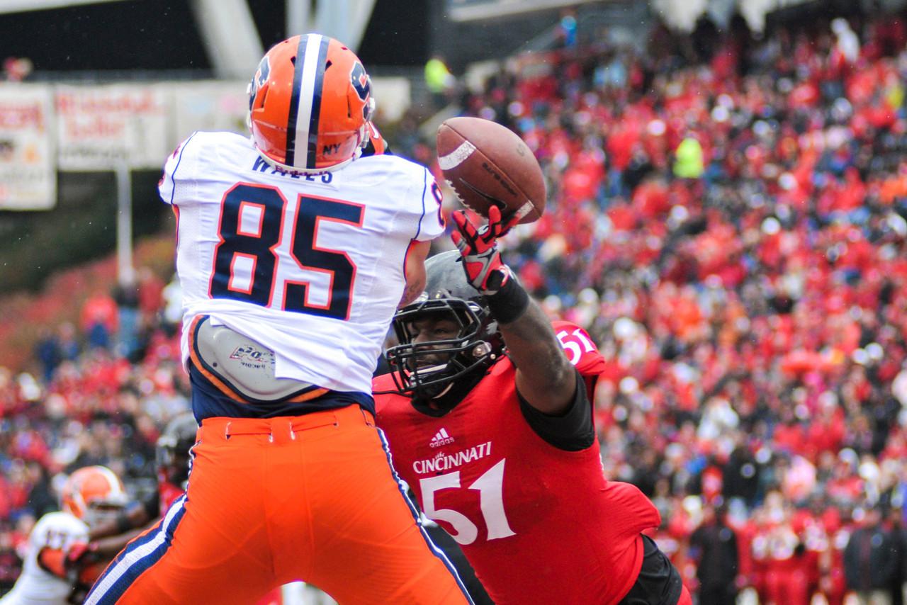 Cincinnati Bearcats linebacker Greg Blair (51) breaks up a pass on Syracuse Orange tight end Beckett Wales (85) in the endzone.  Syracuse Orange lead Cincinnati Bearcats (17-14) at the half at Nippert Stadium in Cincinnati, Ohio.